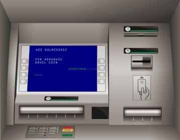 Plastik kart ATM-ə daxil olunur və PİN-kod yığılır.