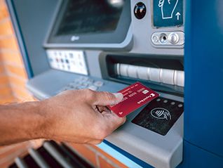 Introduce your card to an NFC device.