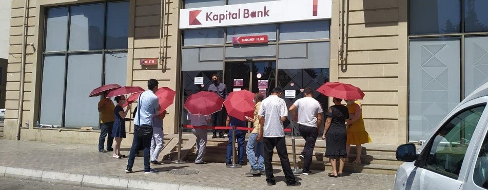 Kapital Bank helps clients protect themselves from the sun in front of branches